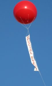 Colorado advertising balloons shown in sky